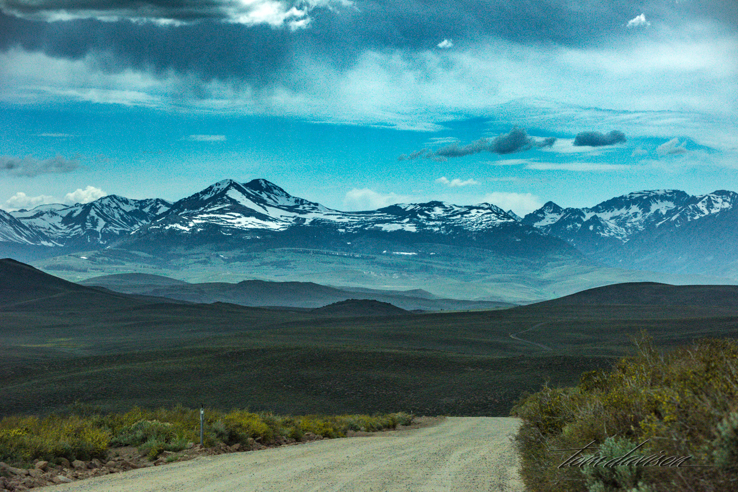 The last three miles of the road into Bodie is an oftentimes bumpy gravel road. While I focused on making sure I did not drop the car too far into a big hole, Tom focused on the mountains in front of us. He had the better job!