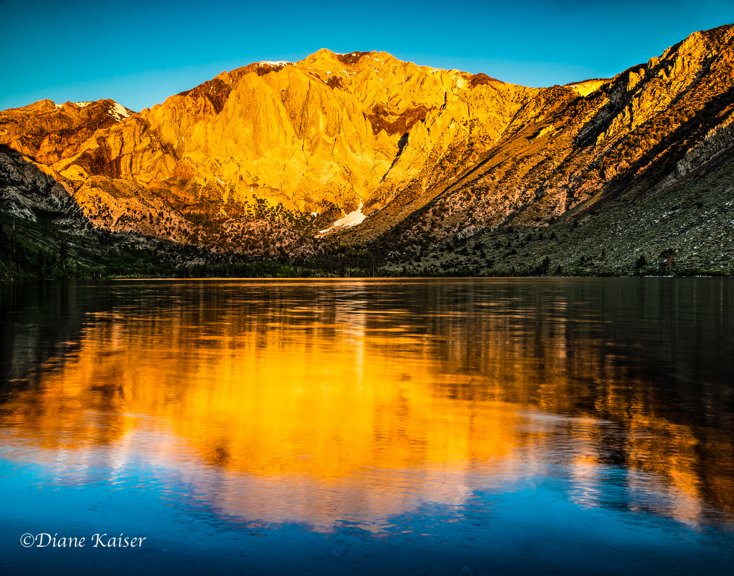 Nope.  You are correct!  This is not from Mammoth Lakes.  Diane took this at a different date than the ones I posted of Convict Lake earlier.  But, I do not want you to miss out on her excellent photography!  She was using a new to her Nikon D810 with a new lens and she was quite the trooper figuring it all out and then captured the full magnificence of sunrise on this popular mountain.  I just love her reflection.