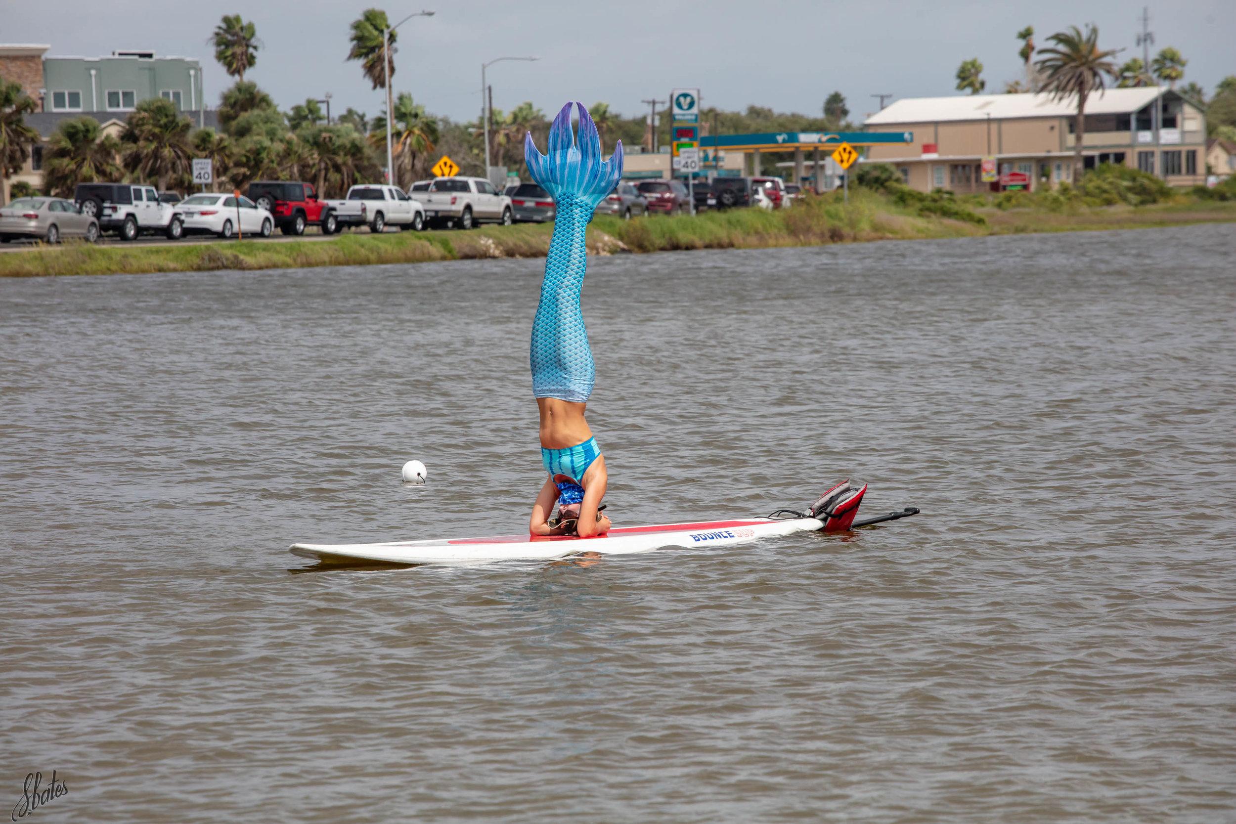 This mermaid teaches kayaking.