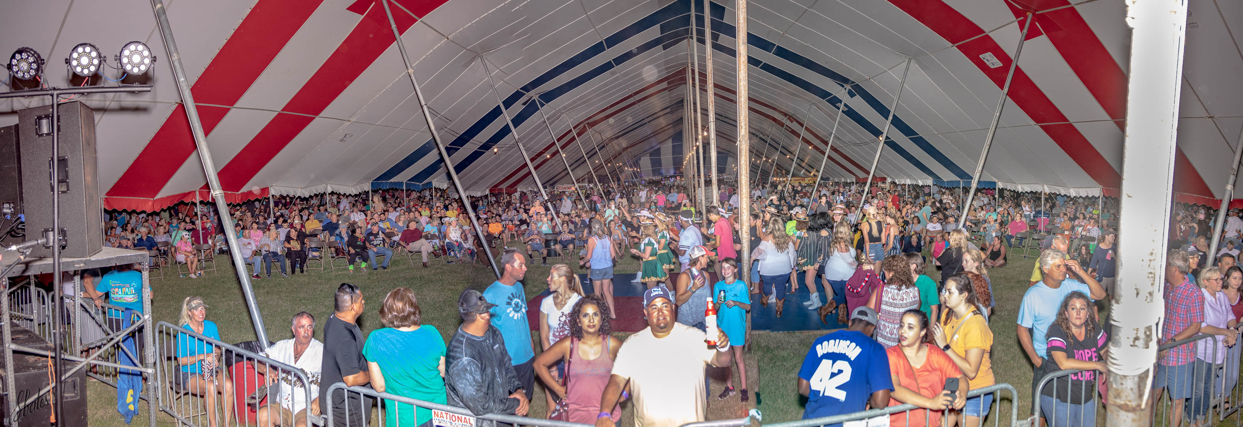 View of crowd forming to watch the Spazmatics band. Steve used his most powerful flash to light up the whole tent.