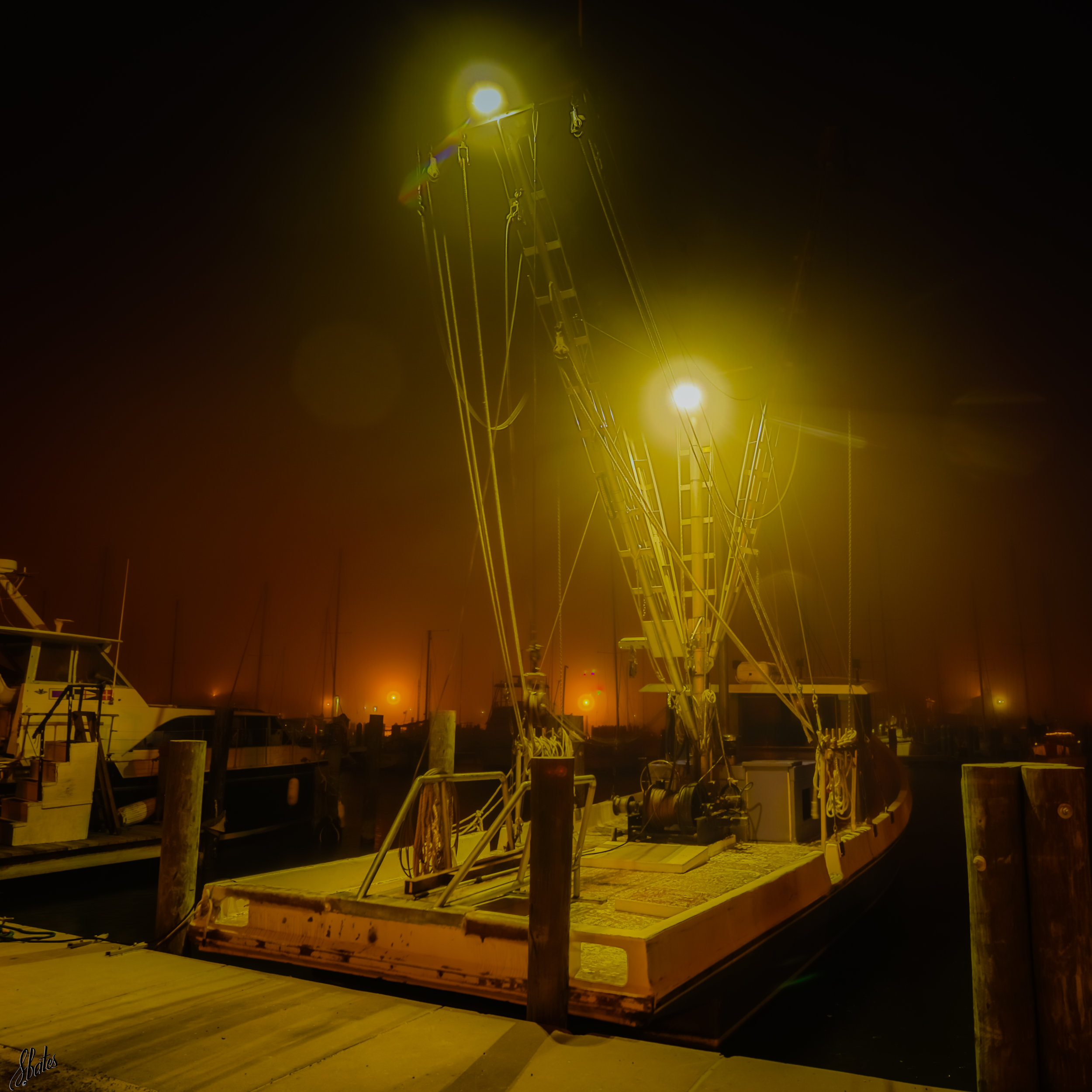A foggy pier offers a different feel on a cold night.