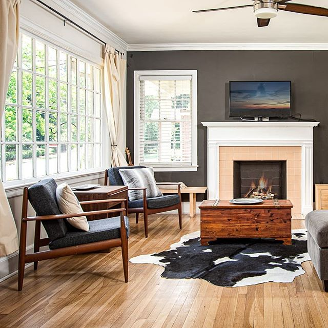 So cozy, proof that the right accent color and a cow hide rug can fix up any room!