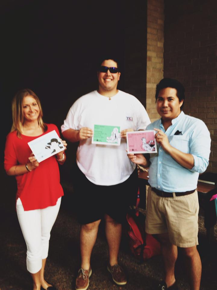 Melissa Bias, Kevin Arevalo and Gemrick Curtom at a recruitment event at the JJVSoC during a communication student organization fair.