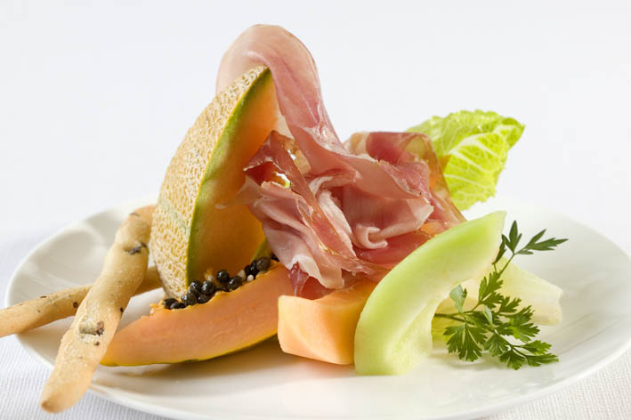 Canape of rockmelon, honeydew & mango wrapped in shaved Prosciutto Borgo