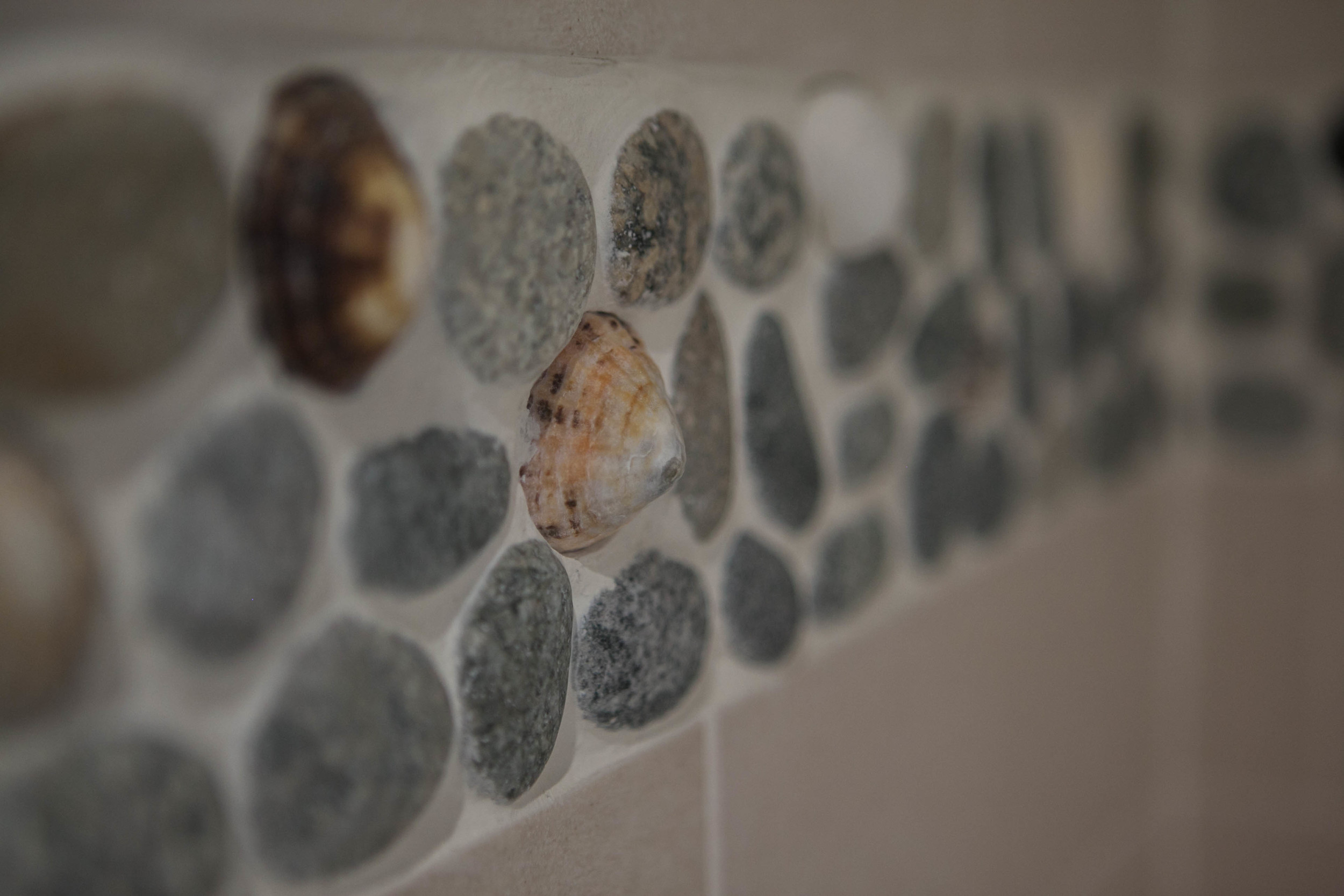 The tiling features real shells from Scarista beach