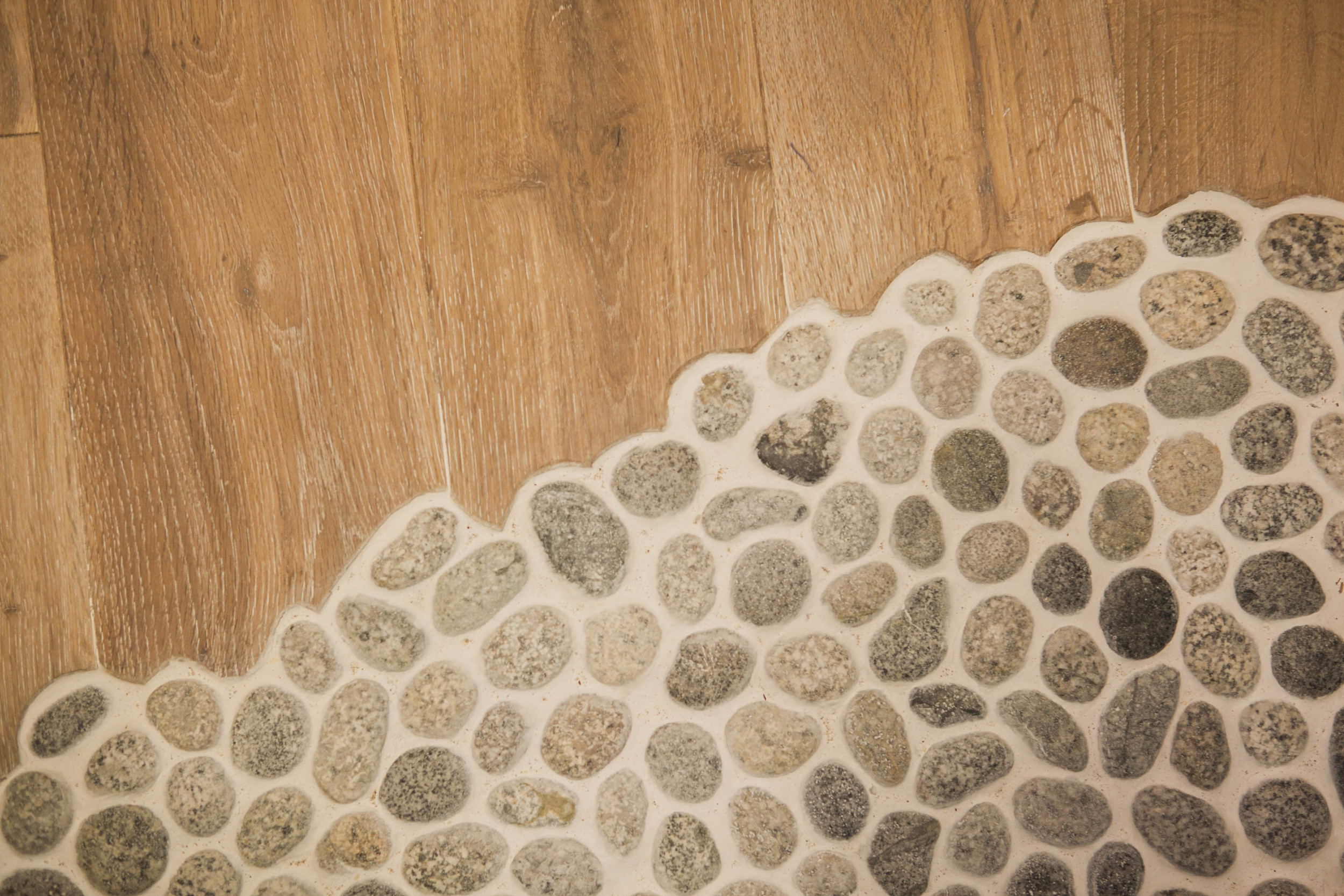 """The pebbles are heated and """"flow"""" under the door to meet the flooring outside the room"""