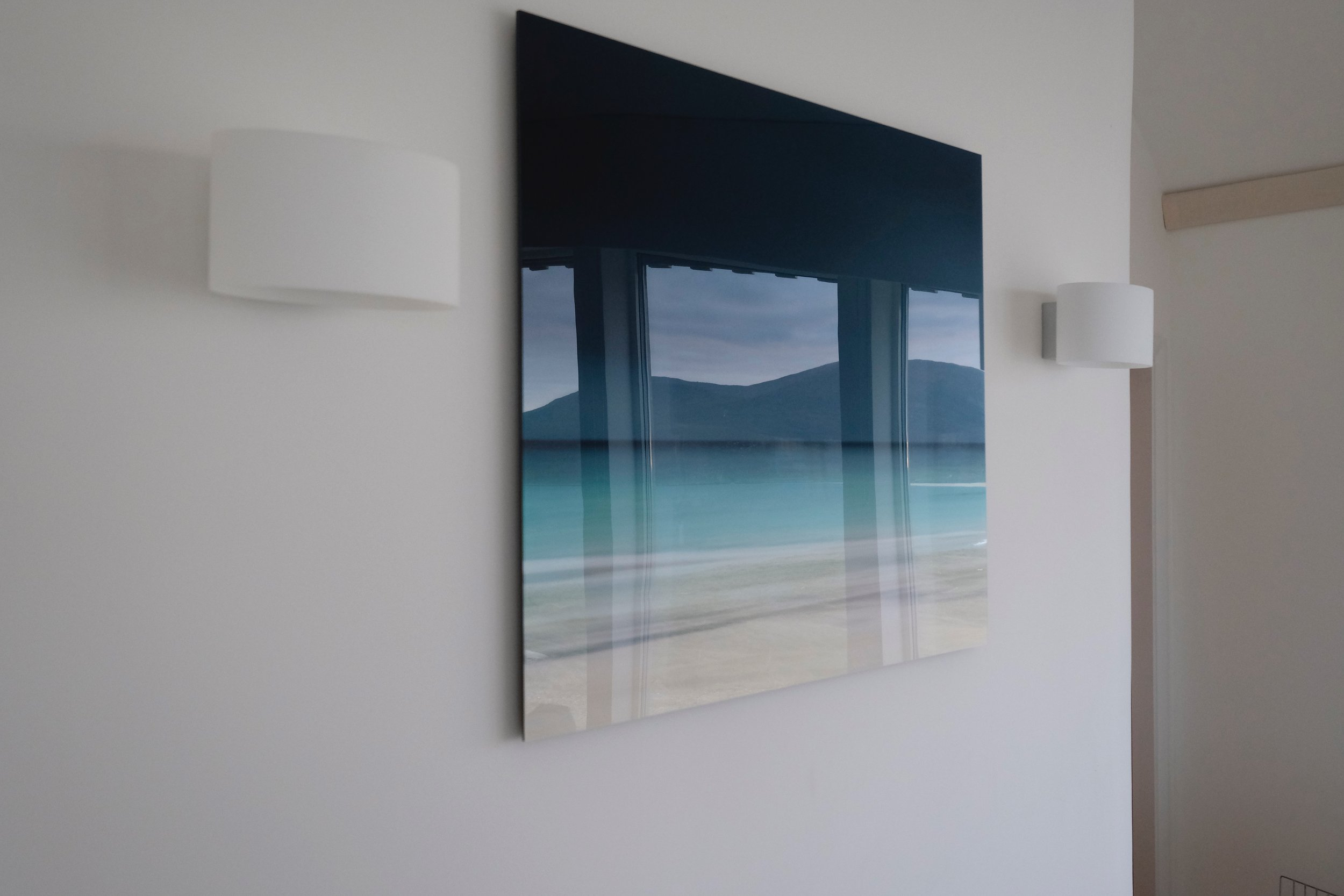 "The real scene outside reflected in Dudley Williams' superb photograph ""Before Rain"" in the lounge area at Oran na Mara"