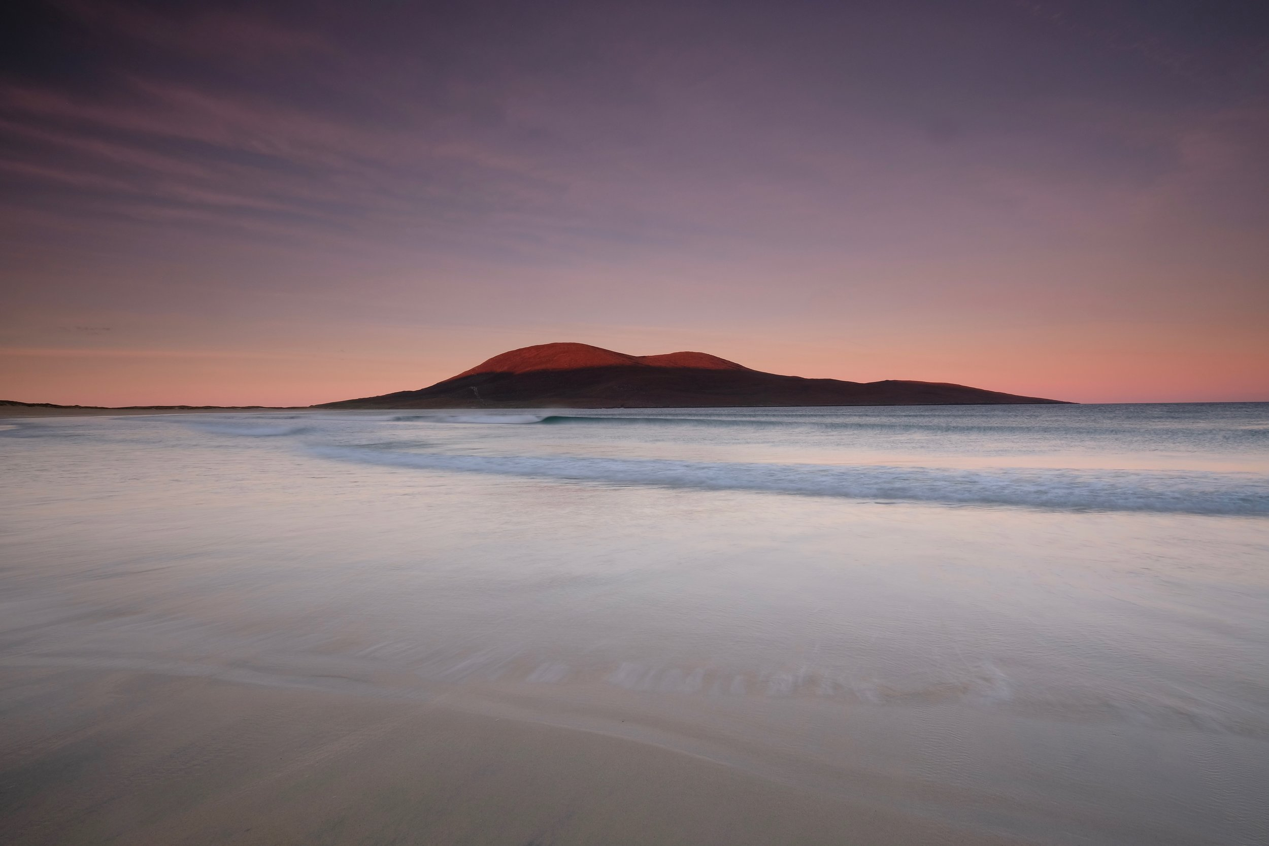 Oran na Mara directly overlooks the spectacular 2 mile curved bay of  Scarista beach with the iconic Toe Head (Chaipaval) peninsula as the backdrop, with stunning sunsets and colours that cannot be adequately described