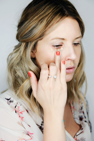 Using your ring finger again, tap out the concealer and make sure to blend it into the foundation so there are no harsh lines.
