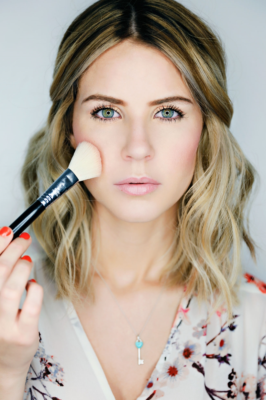 Take a  Sigma F40 brush and apply your blush to the apples of your cheeks, blending it into the bronzer. Again, I'm all about peach tones so my go to blush lately is  Style by Mac.  It has a very slight shimmer to it to really help make your skin look glowing.