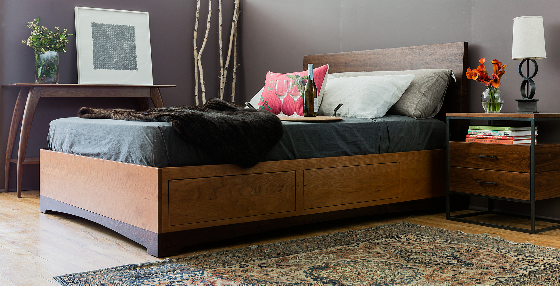 Eastern Console shown in walnut, the Modern Storage Bed in cherry and walnut, queen size & custom steel nightstand.
