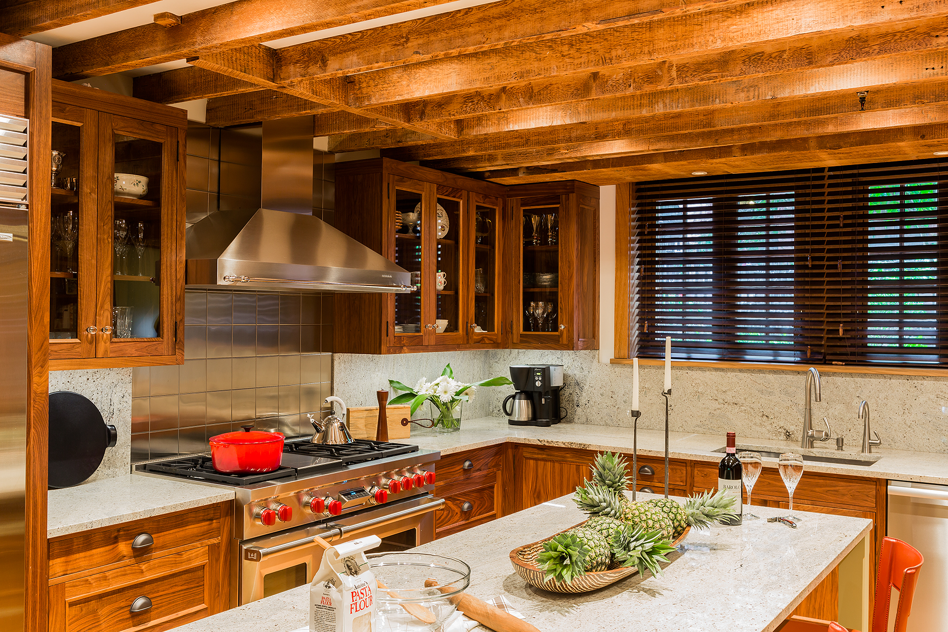 Beacon Hill walnut kitchen with original beams, stainless steel tiles and Kashmir granite.