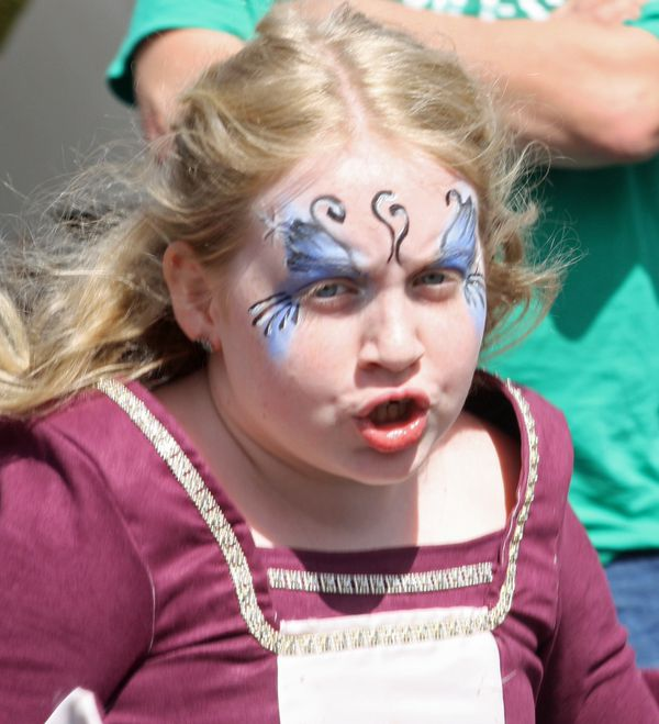 A young performer at Art on R' Mountain art festival.