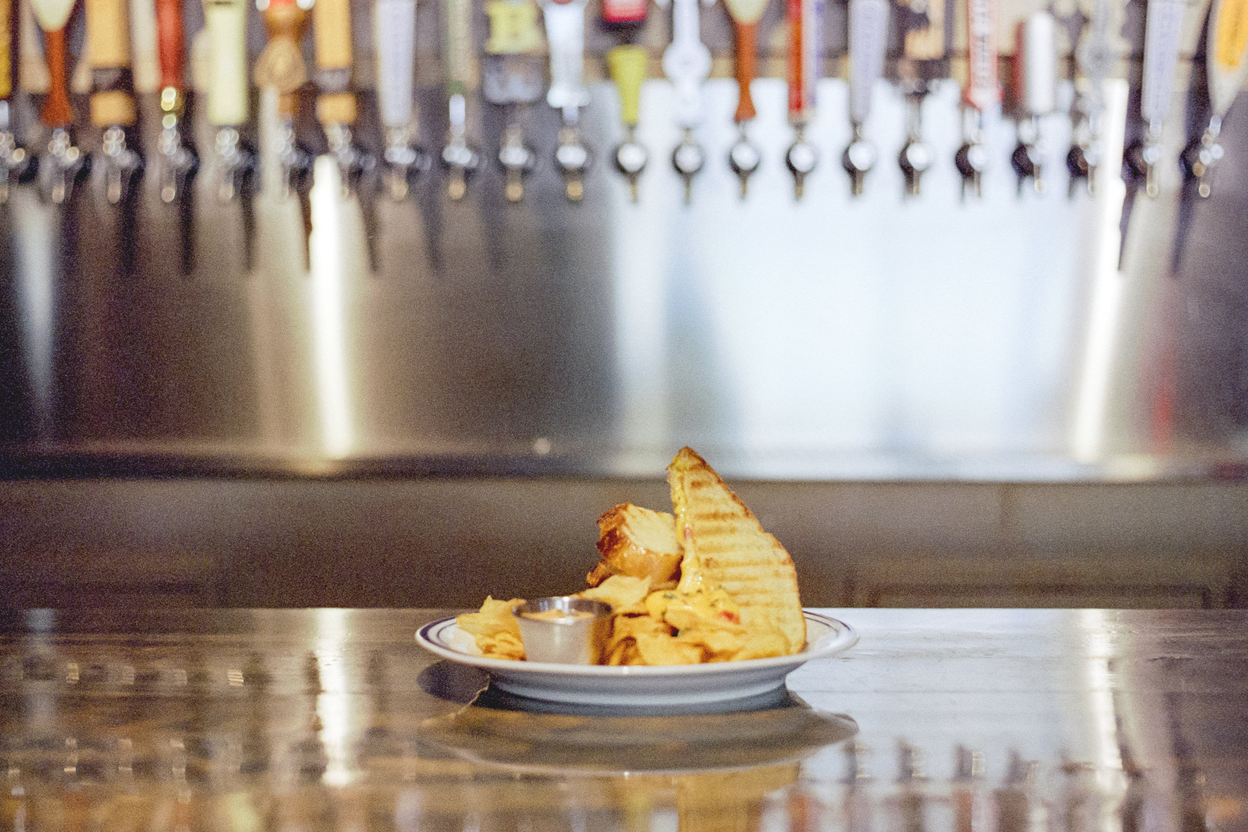 GRILLED PIMENTO CHEESE | aged sharp cheddar & goat cheese. roasted red peppers, fresh thyme, chips & smoked chili aioli