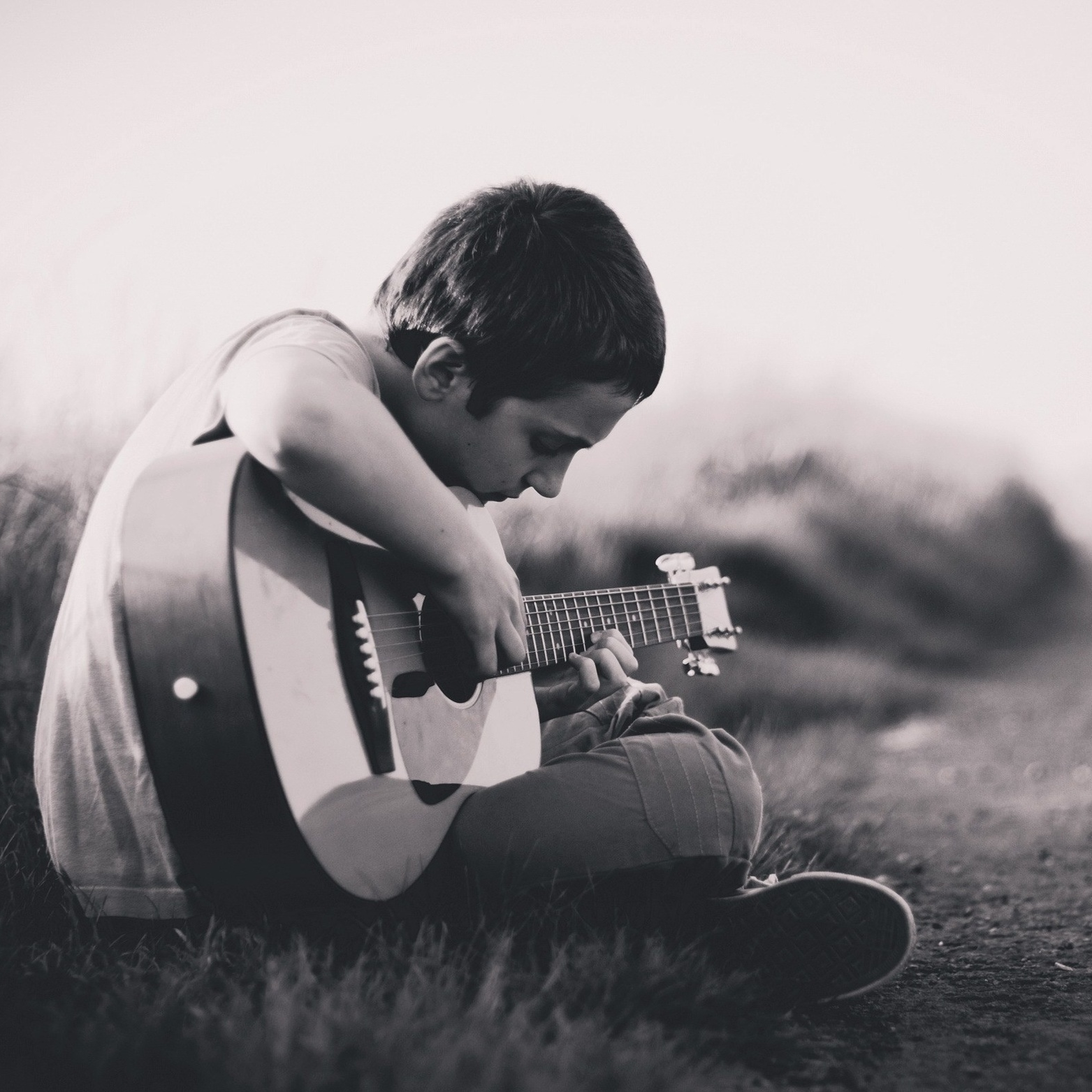 child learning to play guitar