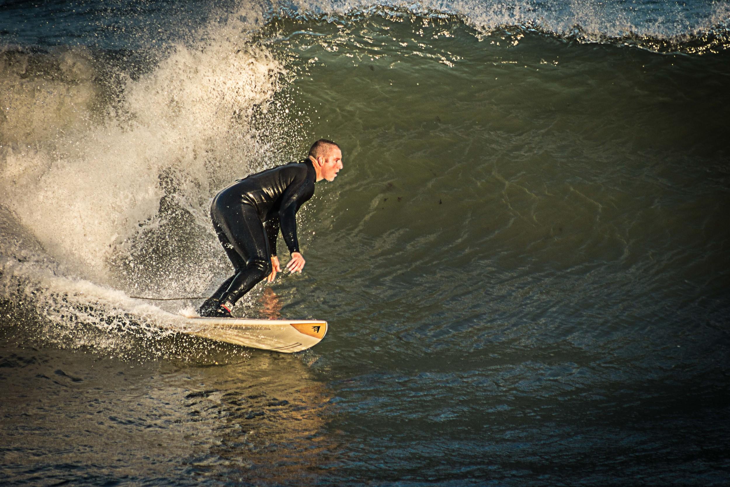 Surfer drops in