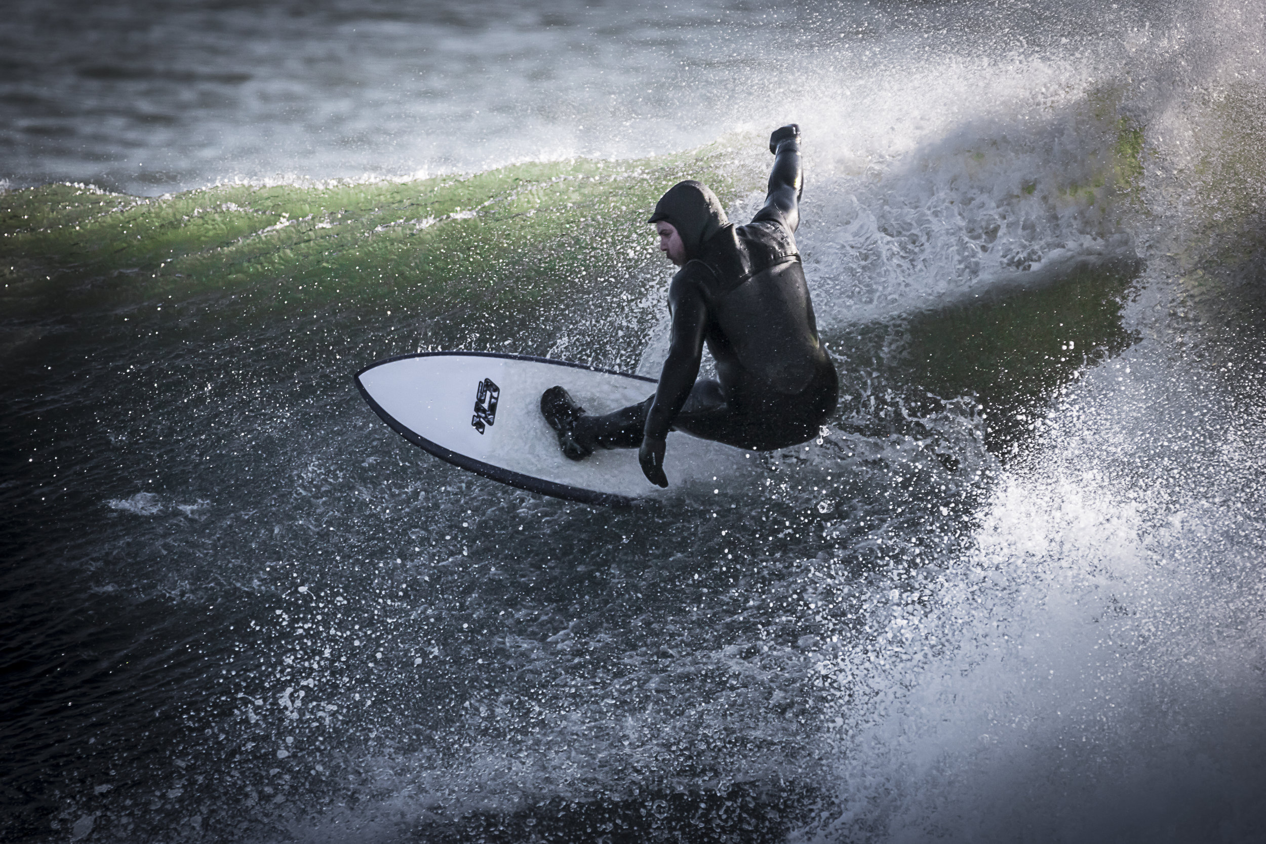 A surfer rips up the face of a double-overhead wave a day after Winter Storm Stella passed the Rhode Island shore.