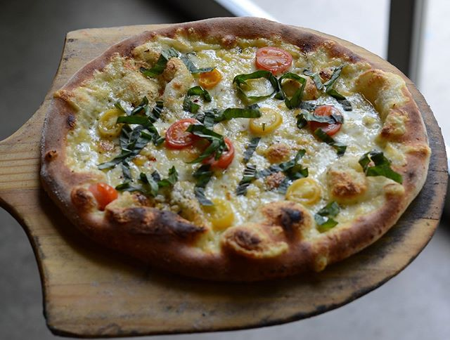 It's never too early to think or talk about pizza! We will have a white pizza with fresh grape tomatoes and chopped basil on the menu for this weekend.