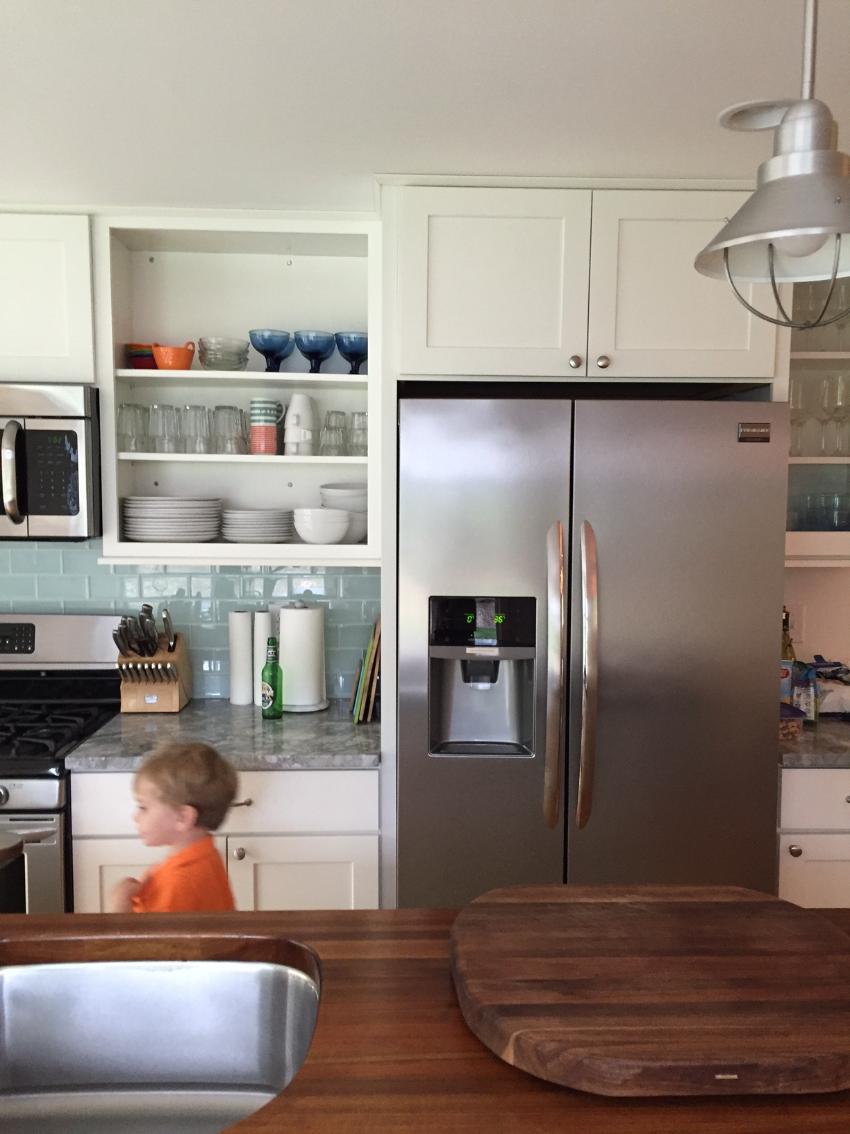 A closer view of the kitchen (don't mind Charlie or the bottle of Peroni!)