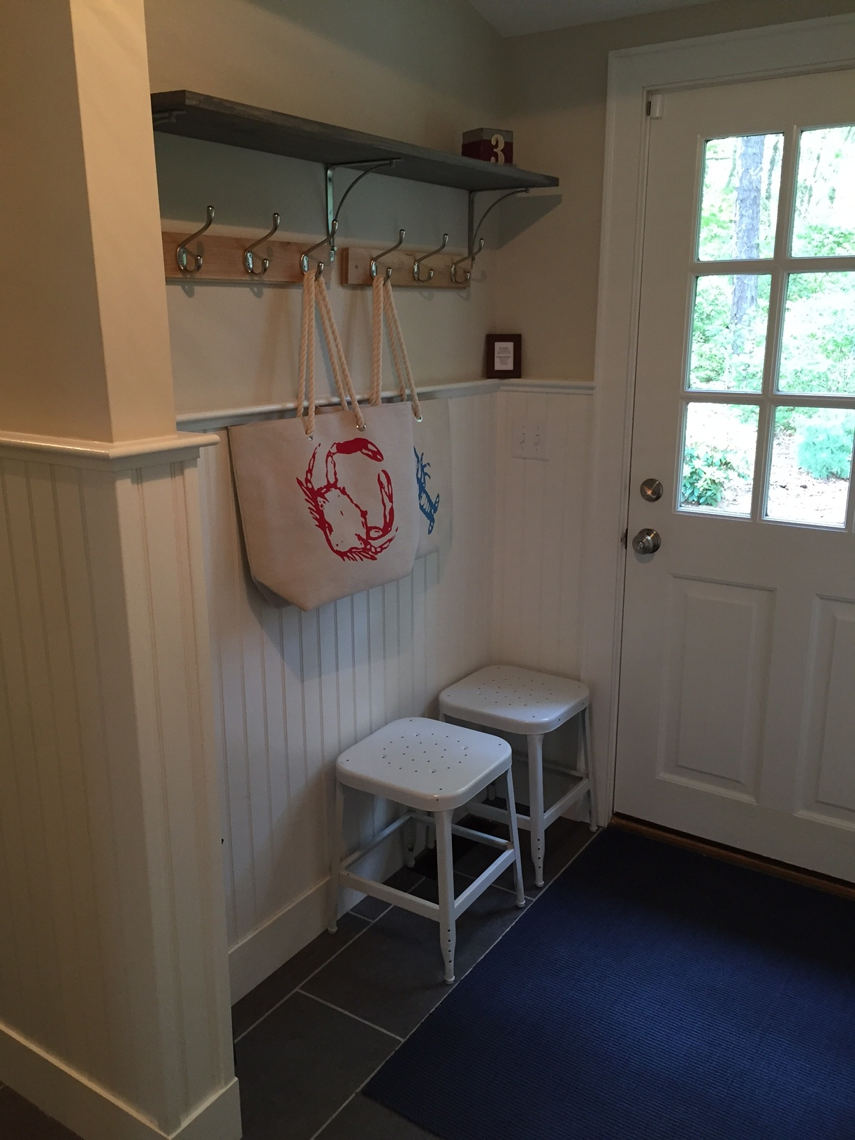 The mudroom on the way to the outdoor shower. So nice of the owners to leave beach bags and beach towels (not pictured) for guests to use.