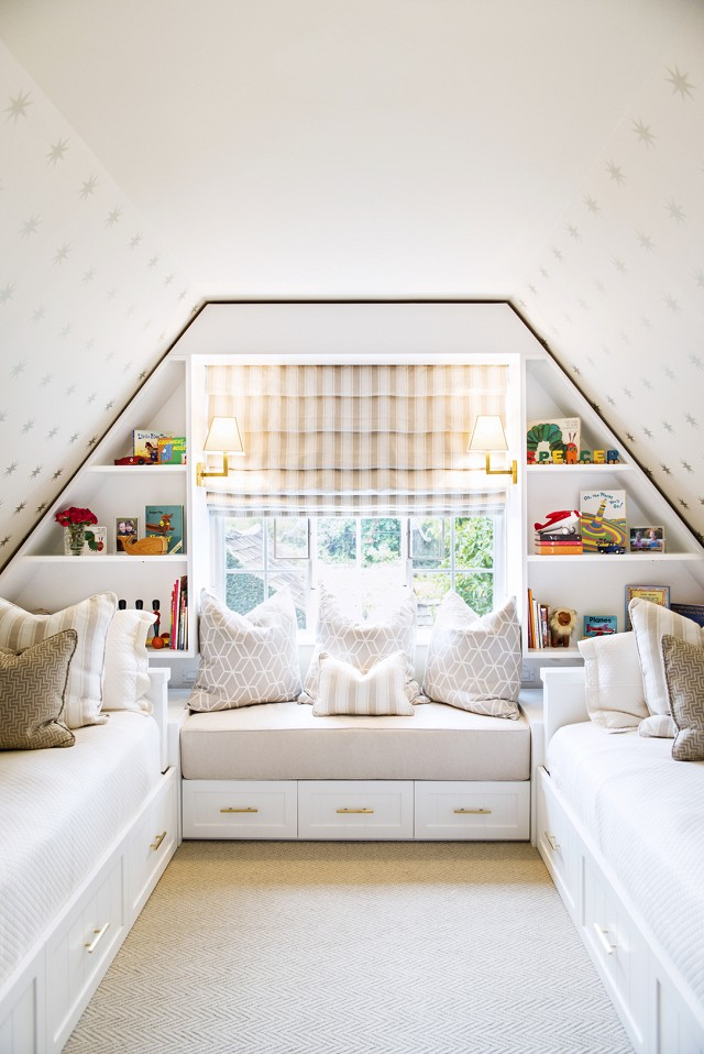 I love that this room could serve multiple purposes - a guest room, playroom and even storage space using the underbid drawers. The carpet really warms up the space and the light colors and fun wallpaper keep it light and airy.  Photo via  My Domaine , design by Shannon Wollack and Brittany Zwickl