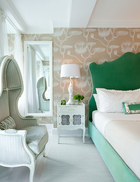 This beautiful headboard makes a statement in an otherwise subdued bedroom.   Image via  Hadley Court .