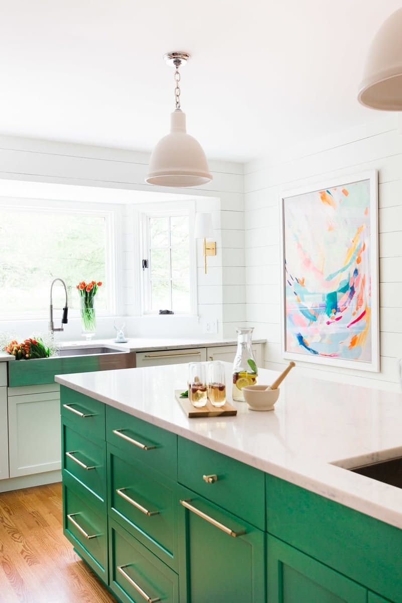 How cool and unexpected is the color on this kitchen island?I would love to cook in such a bright, fun space!  Image via  The Kitchn