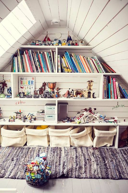 It doesn't look like they did much to turn this attic into a playroom.  Just a coat of paint on the existing wood board walls and floor.  Very cute, rustic and functional!  Image via  Domino