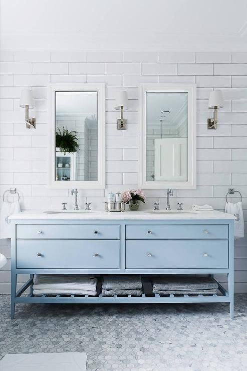 The vanity and tile floor brings in the icey blue color to this bathroom.  It feels so crisp and clean, but definitely cool.  To warm it up, I might swap out the chrome fixtures and hardware for brass.  Still a beautiful bathroom that I'd love to have in my own home.  Image:  Frog Hill Designs