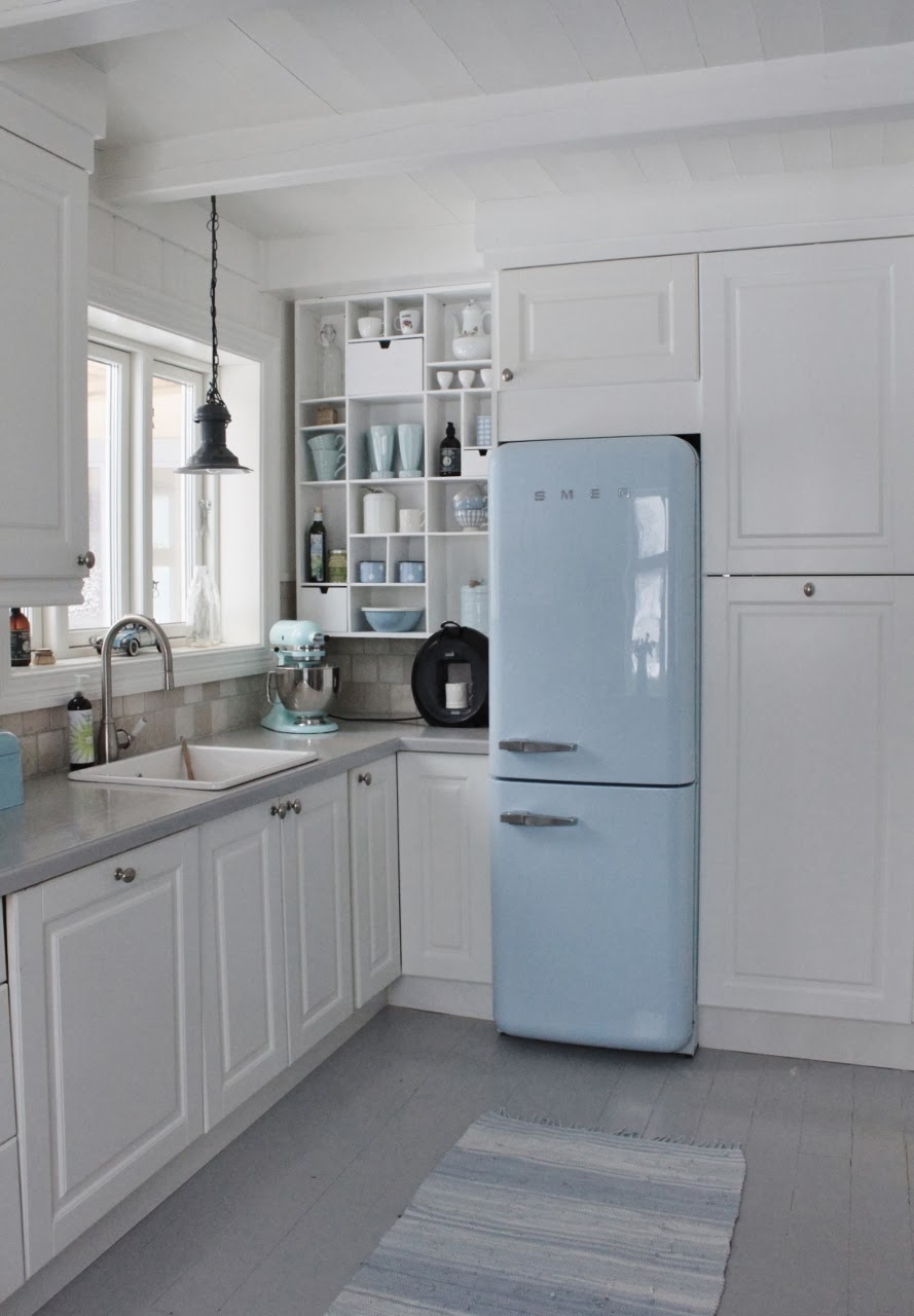 Last but not least, this kitchen brings the blue in via the retro  Smeg  refrigerator and accessories.  It's also a fun and unexpected way to add some color to a kitchen.  Image:  Mia's Interiors