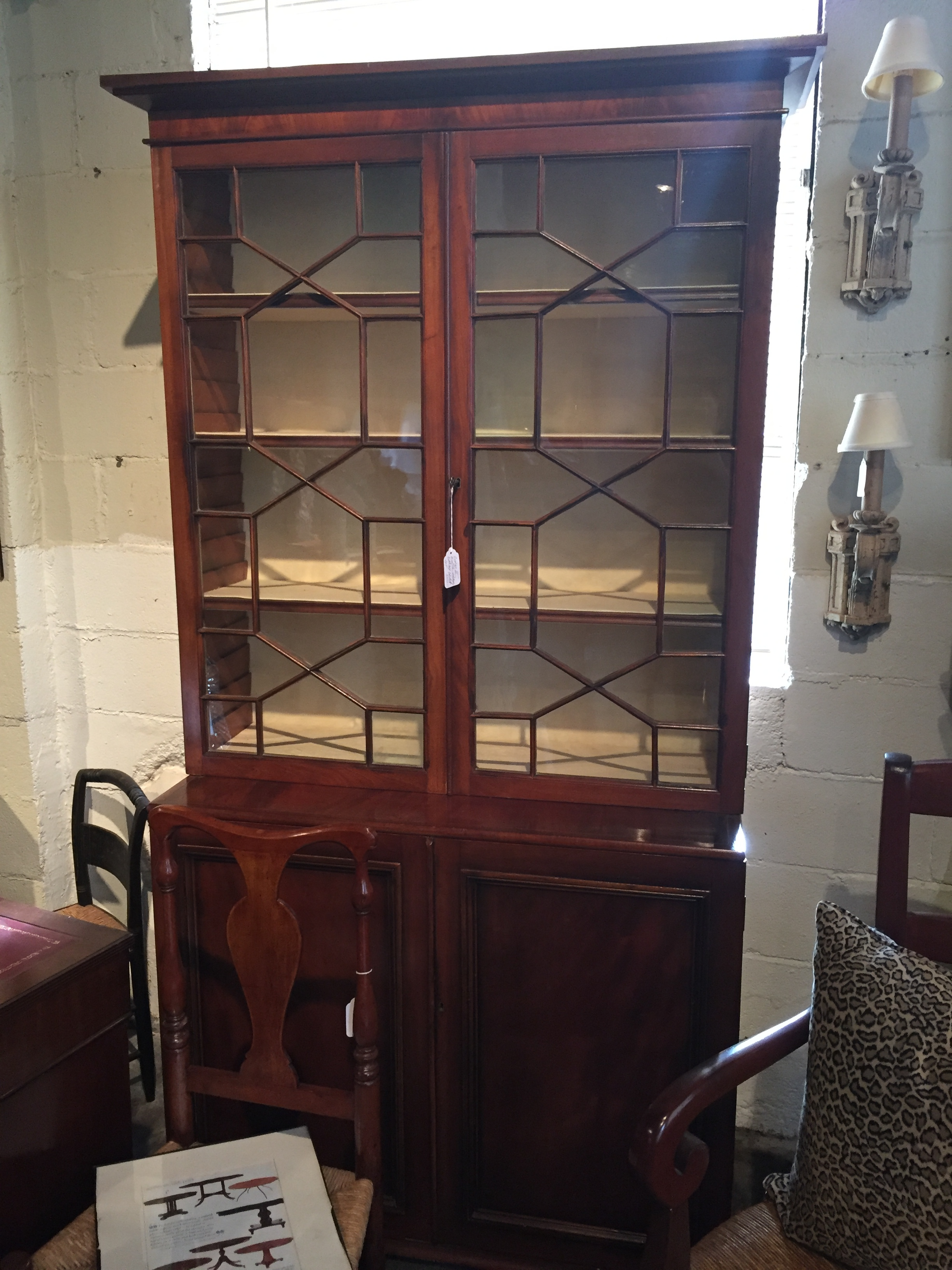 This early English 19th century George II  mahogany bookcase  was stunning in person. And it could go traditional or modern depending on the room.  I love the geometric pattern on the glass doors.