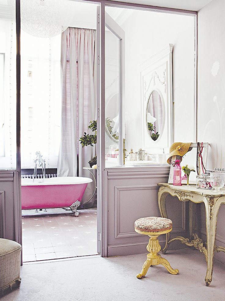 This bathroom is oh so French. I really applaud people willing to paint their walls unique colors like this shade of lavender.   Image via  Gravity Home