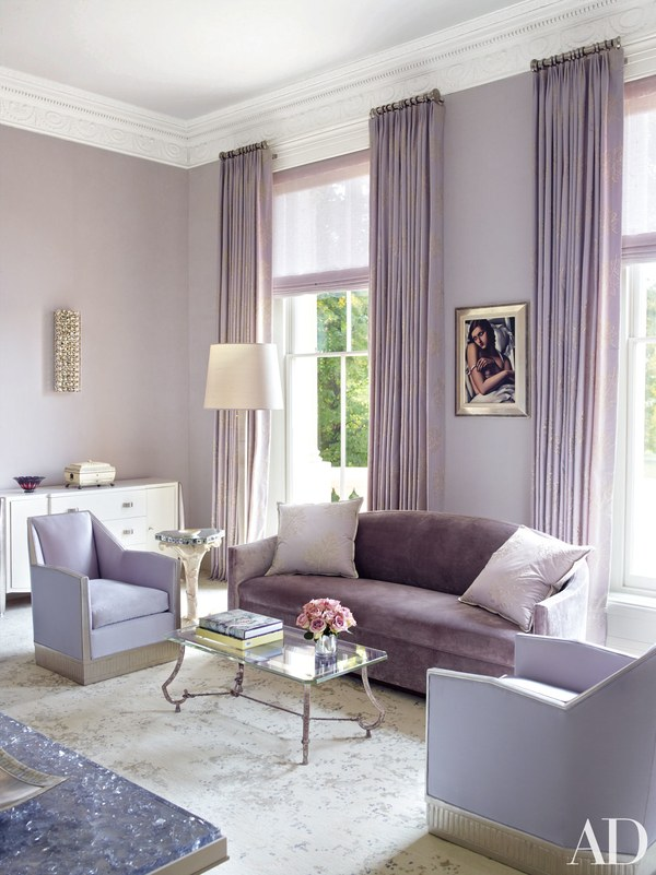 This super sophisticated and monochromatic room feels so feminine. Can you believe the is someone's office space?! I mean wow.  Image via  Architectural Digest
