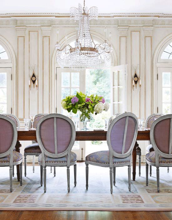 Here is another dining room using lavender chairs. The traditionally of this room is basically the opposite of the room above. Still lovely!  Image via  Traditional Home