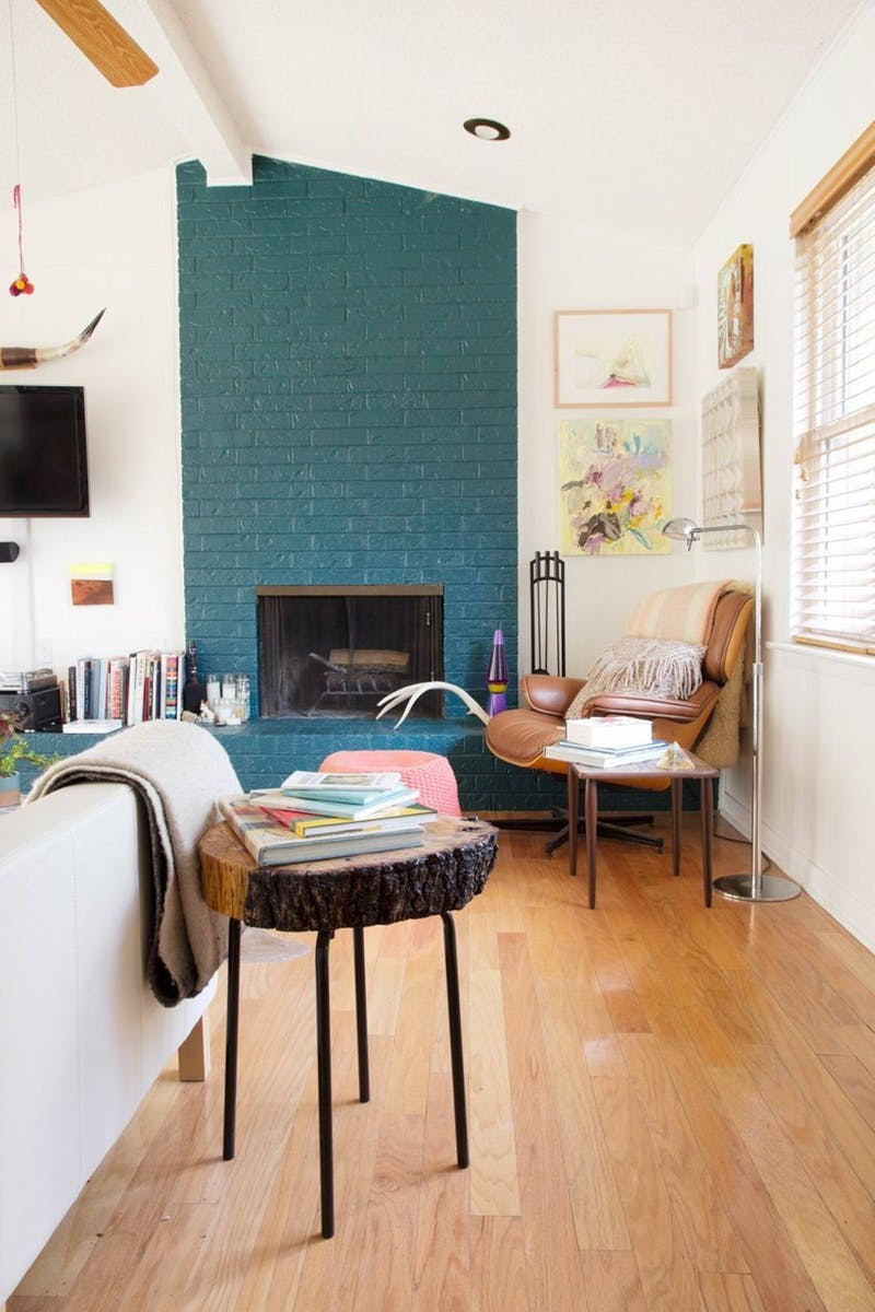 This homeowner used it to update a brick fireplace - an unexpected but happy color for a fireplace.  Image via  Apartment Therapy