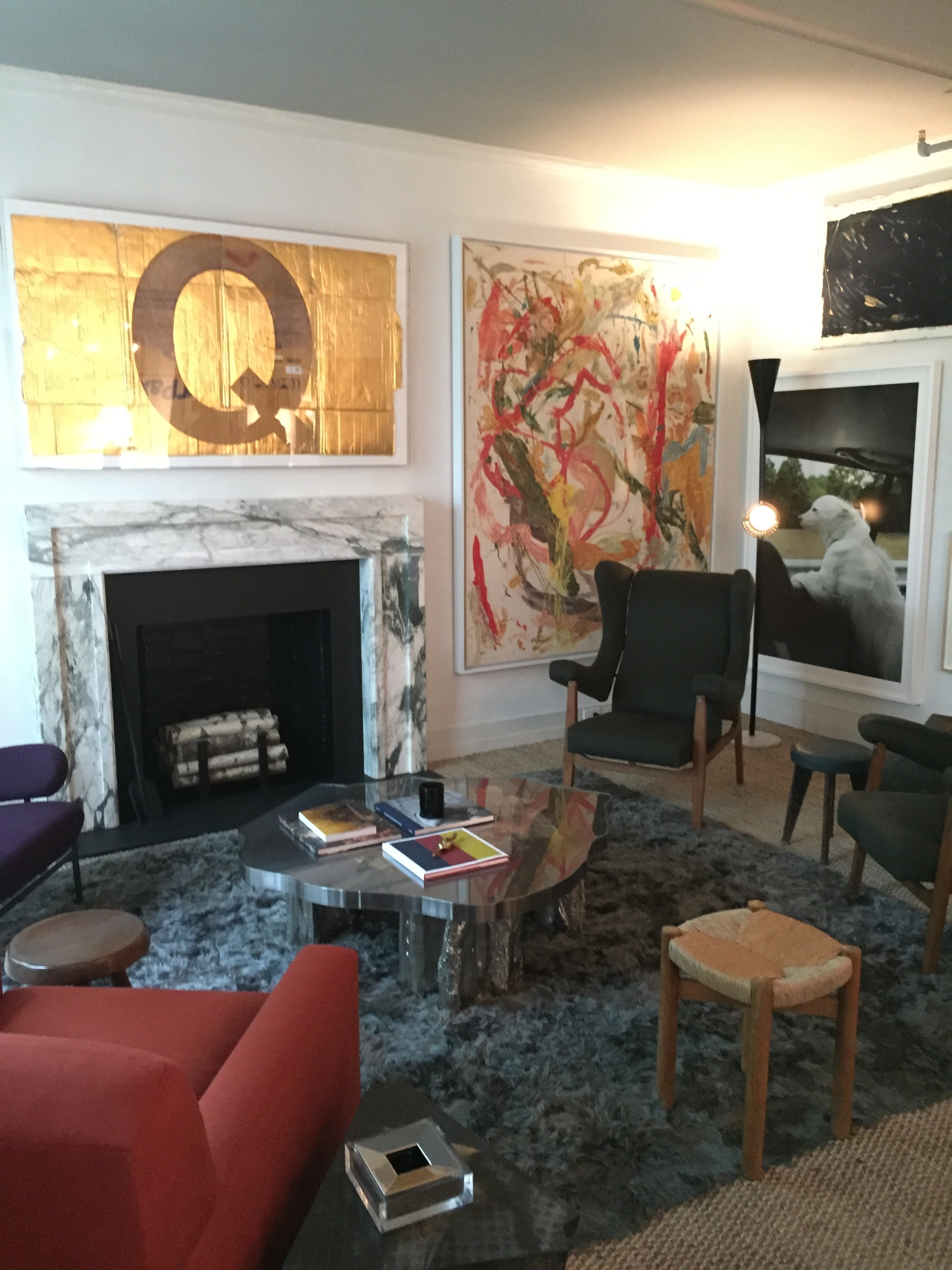 One view of the room - so much artwork in mixed mediums.