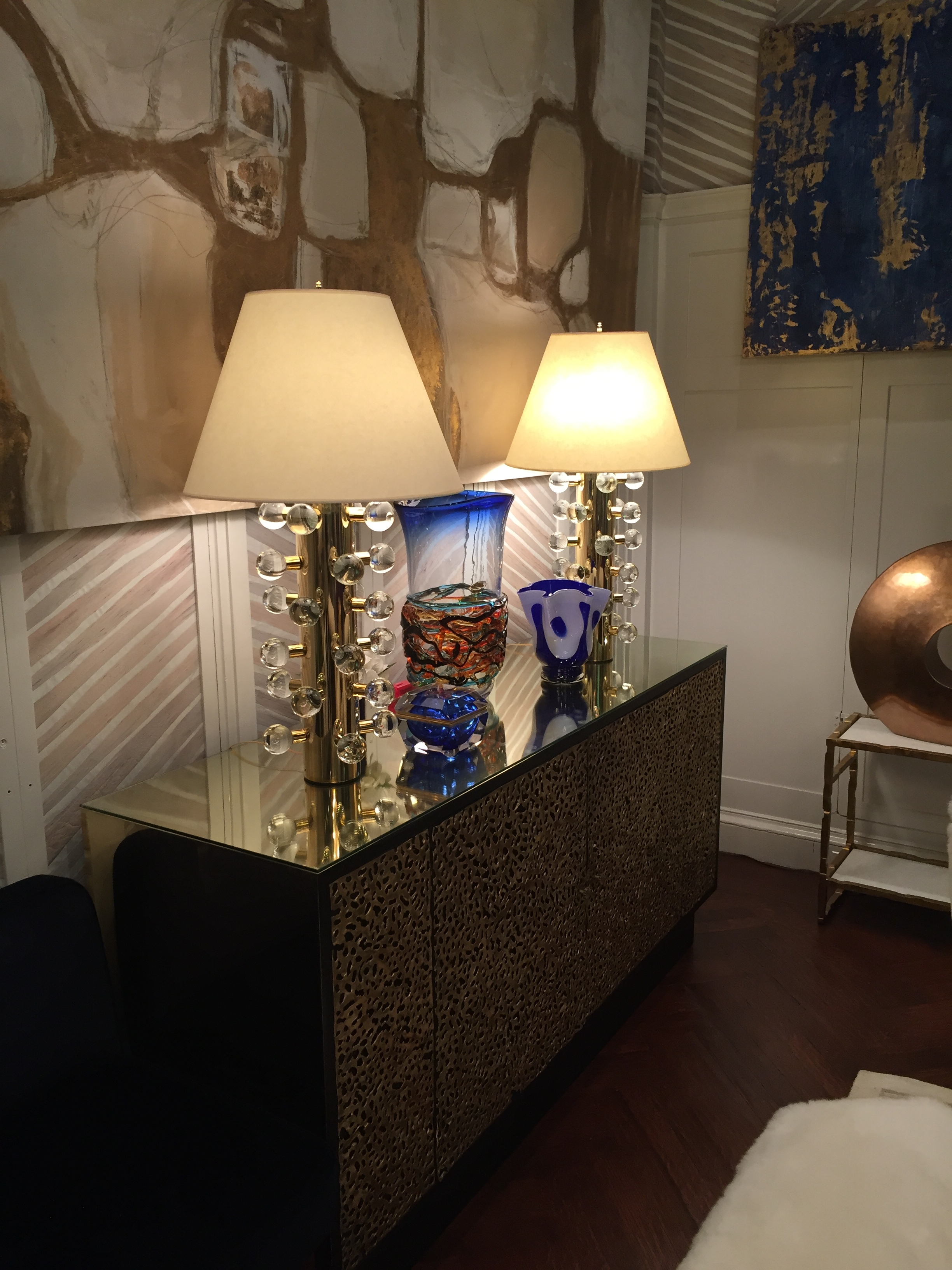 I thought these brass and lucite lamps in the same room were very funky too.
