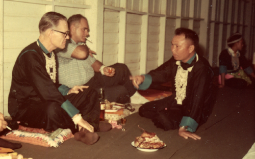 Gen. Vang Pao organized a farewell party for Bill Lair in 1968 at Long Cheng, Headquarters of Military Region 2, in Laos. Next to Lair is his deputy Pat Landry. Courtesy Bill Lair.