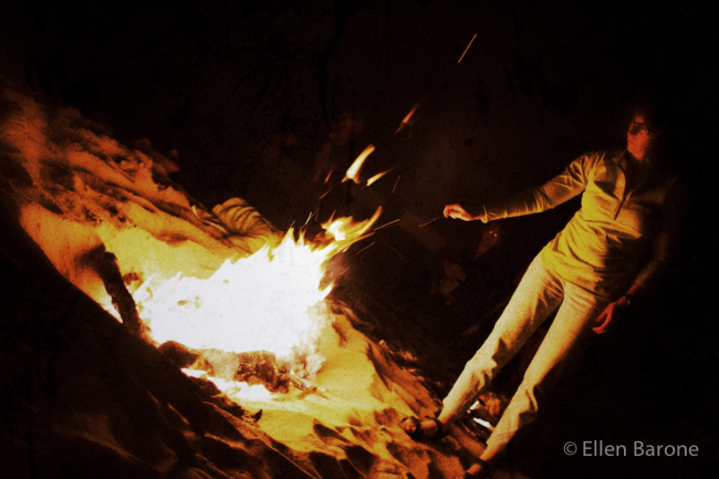 Roasting marshmallows over, beach bonfire, Sea of Cortés.