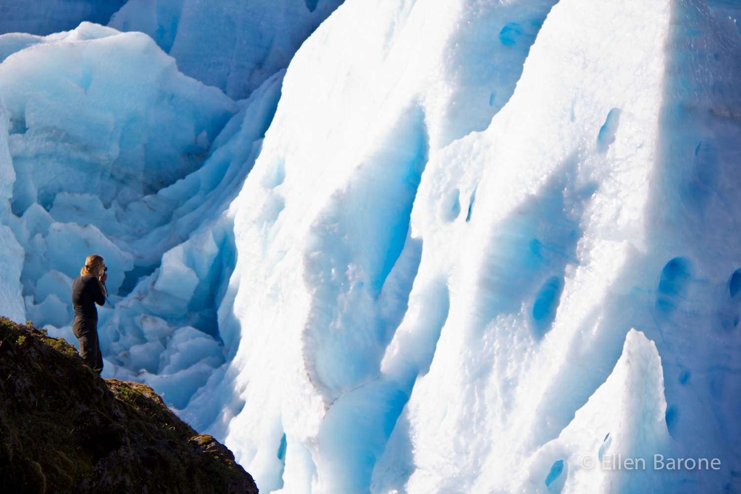 Conservation photographer Bridget Besaw at Melimoyu glacier, Melimoyu wilderness lodge, Patagonia Sur, Patagonia, Chile.