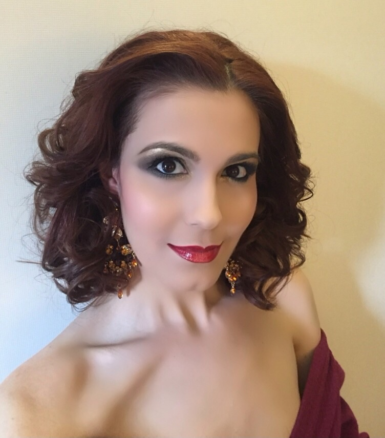 My finished red carpet hair and make-up accessorised with my earrings...