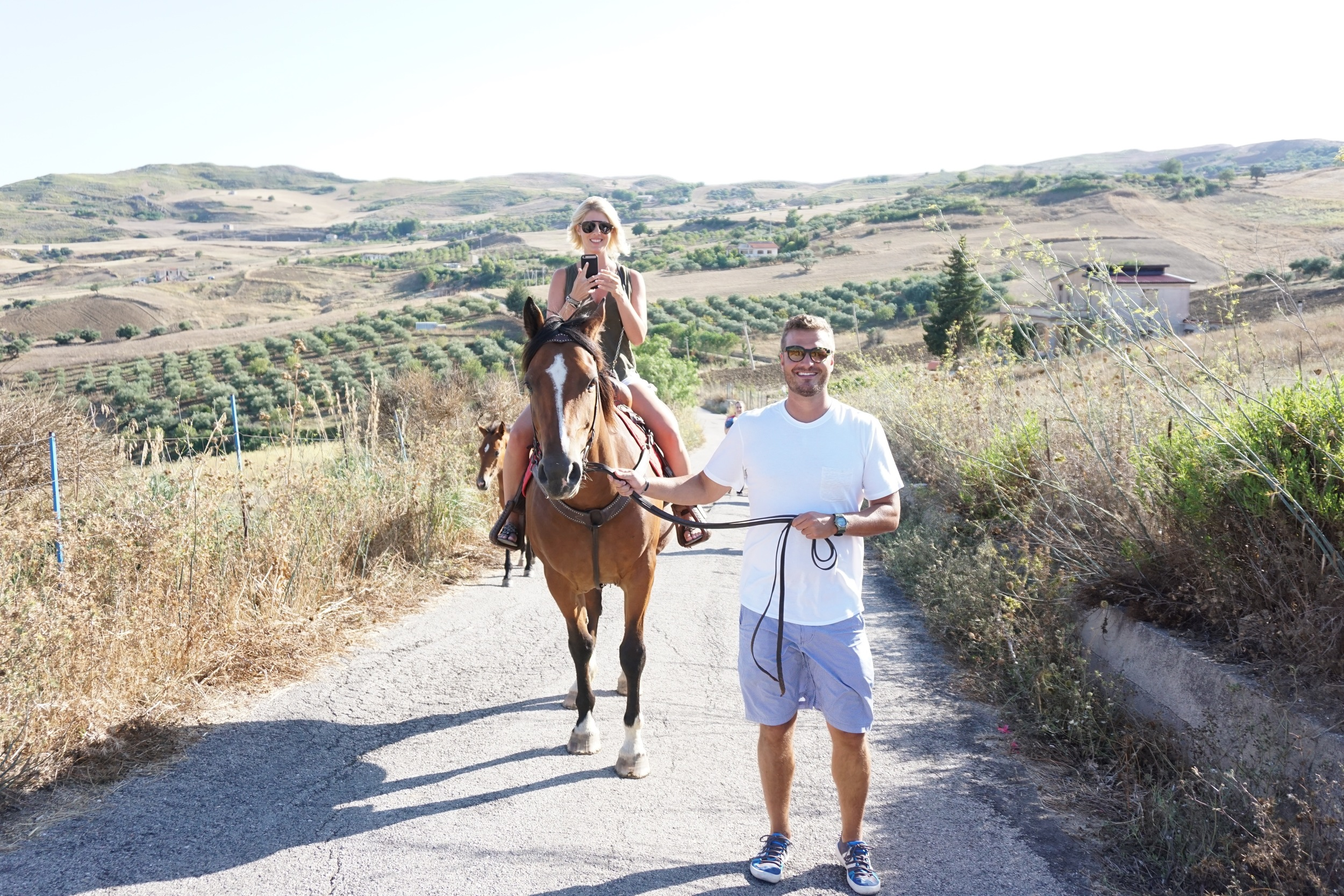 This is something you don't see everyday. Jay and me riding horses though the Sicilian countryside