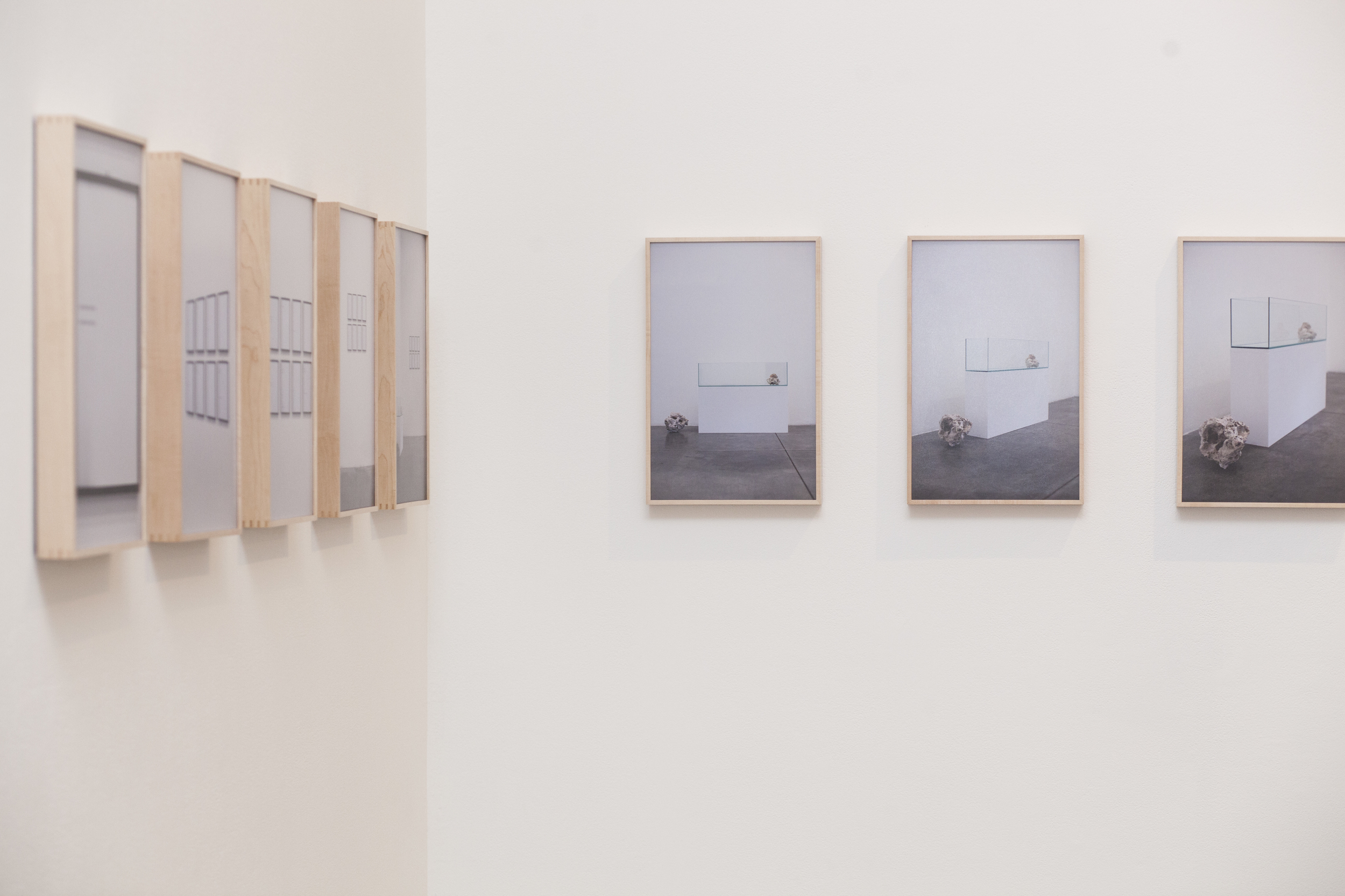 "Ideal Conditions , 2014, Set of 21 11""x17"" photographs in custom maple frames and maple laminate flooring installation"