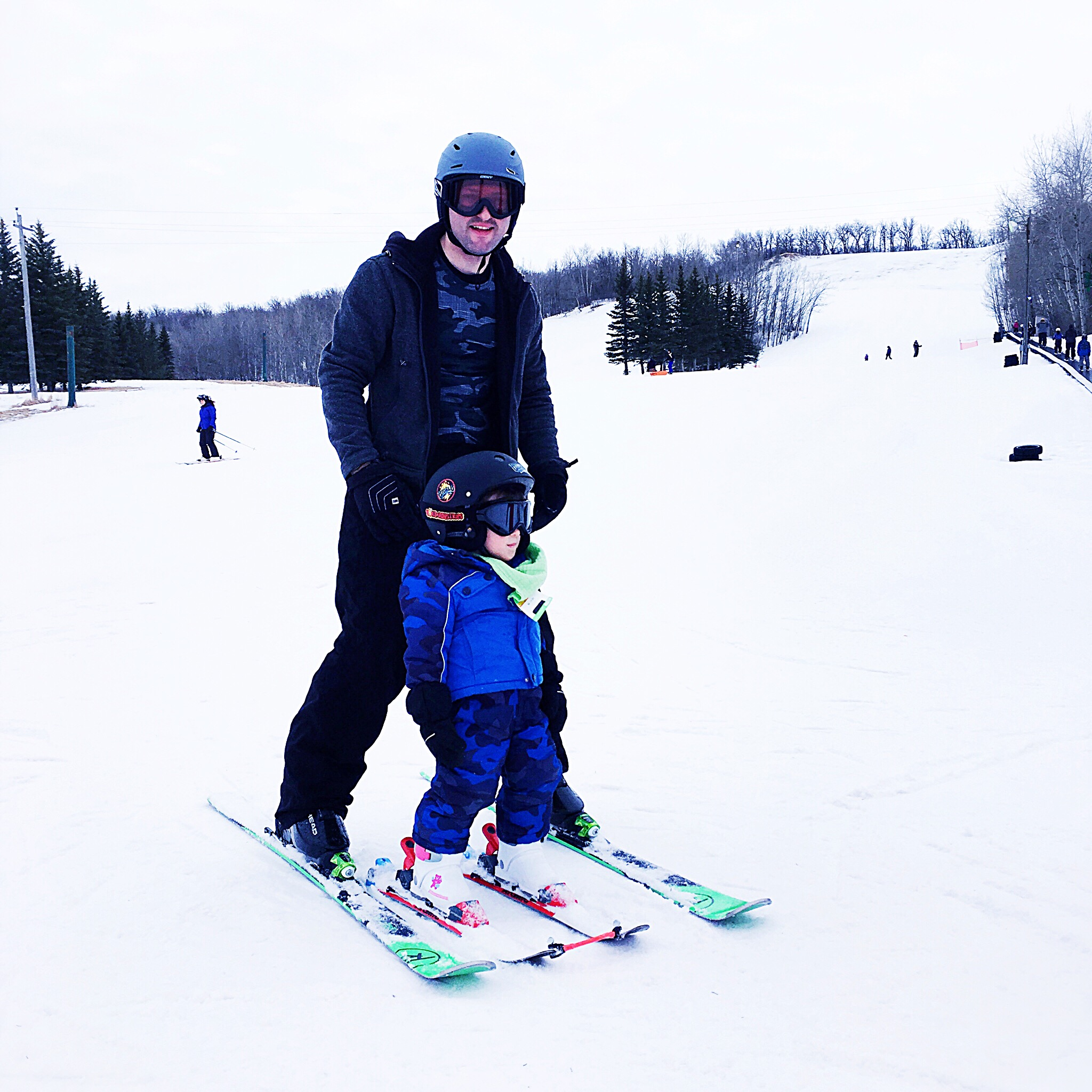 Proud Father and his tiny skier.
