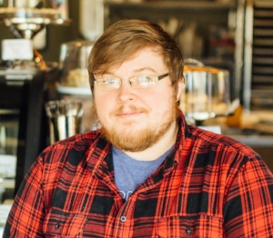 """I have the best group of young people helping this shop crank out pie after pie. This week's featured employee is Tyler but many of you have probably never seen much of him due to the very EARLY hours he keeps. Tyler came to the shop our very first Thanksgiving in 2015, actually before we were ever open but still overwhelmed by the sheer amount of orders then. He is my """"sleeper"""" baker meaning the boy had absolutely no experience but has easily learned so much. He is now a very talented baker and is also in charge of mixing/weighing all our dough used every single day. He does this on top of his assigned pies baked daily. He is a sweet soul and also our resident comedian adding fun to our early routines. Tyler is our diamond in the rough and I'm very glad he's a part of our team."""