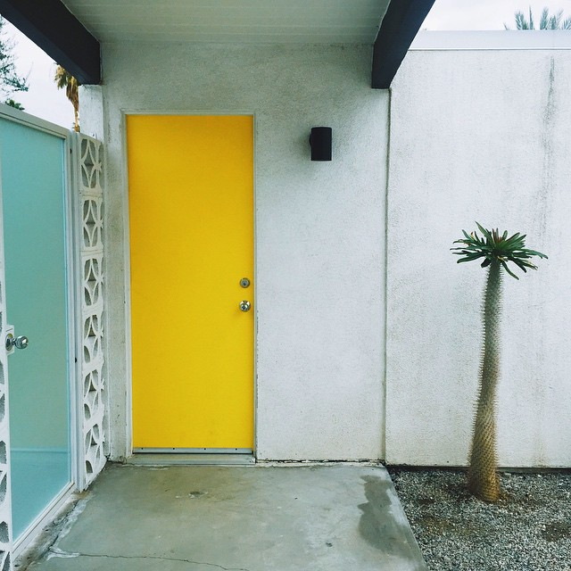 Here's the house we rented in Palm Springs with the cool yellow door! Fourof our staff took the same photoof this door without realizing it - great minds think alike?!