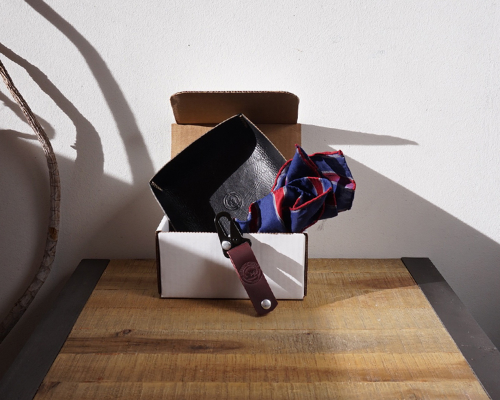 Gift pack featuring leather carryall, keychain and pocket square from Clarke and Barba