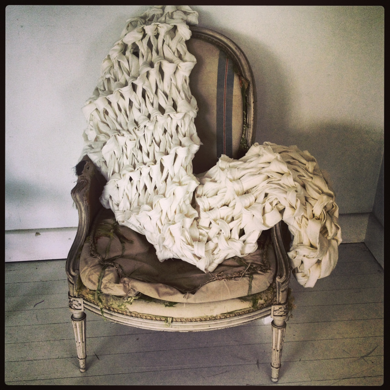 Oversized stitch linen throw over chair