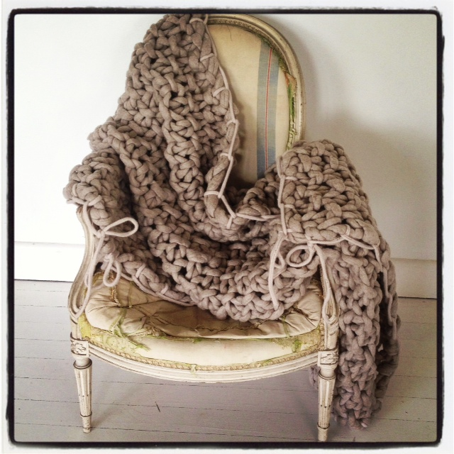 Oatmeal throw with taupe trim over chair