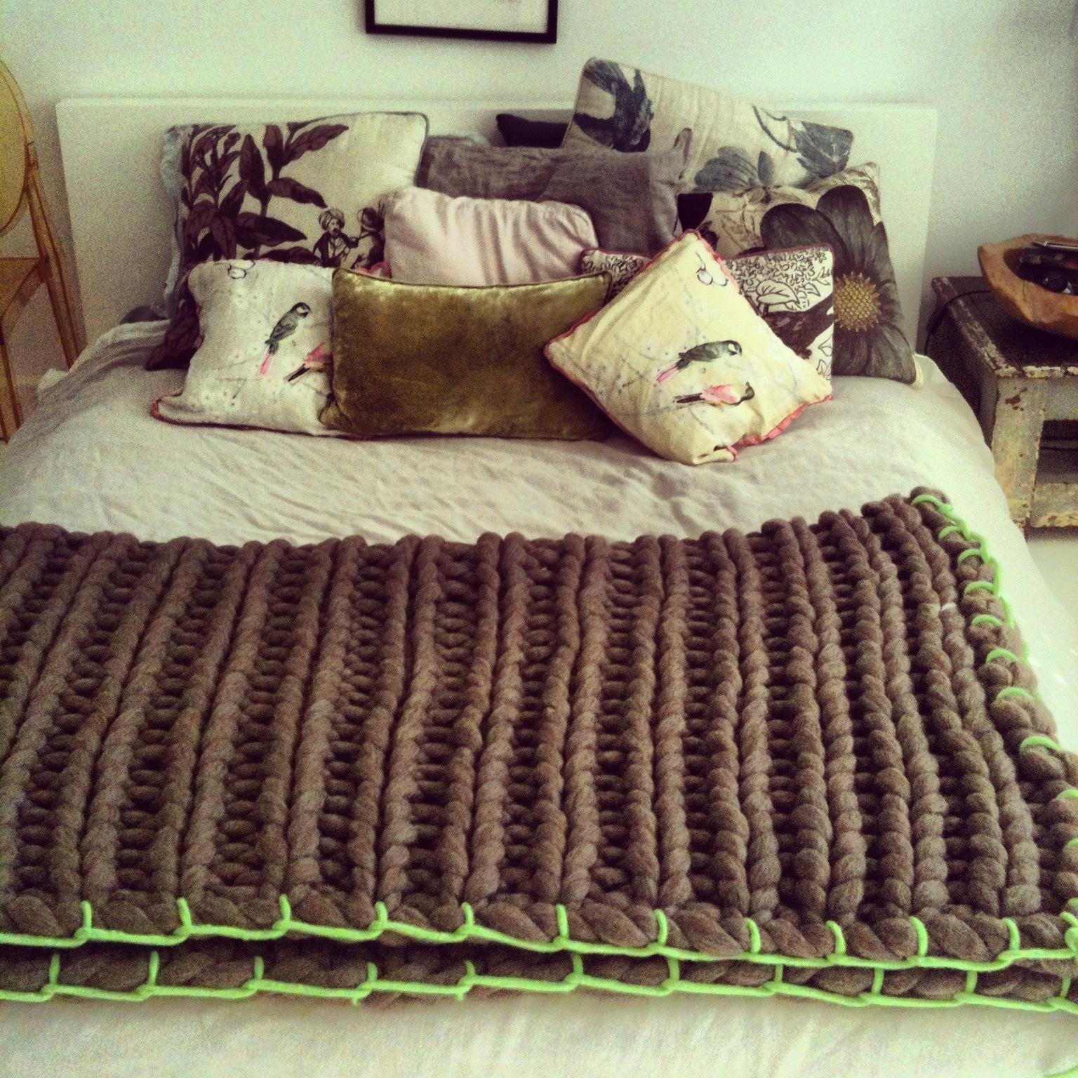 ERL - woollie on bed green trim.jpg